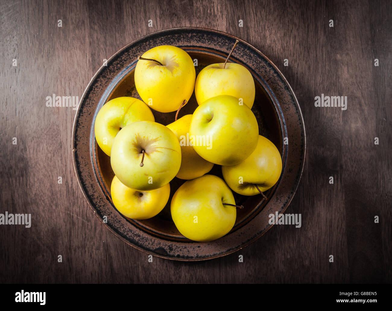 Raw Organic Golden Delicious Apples - Stock Image