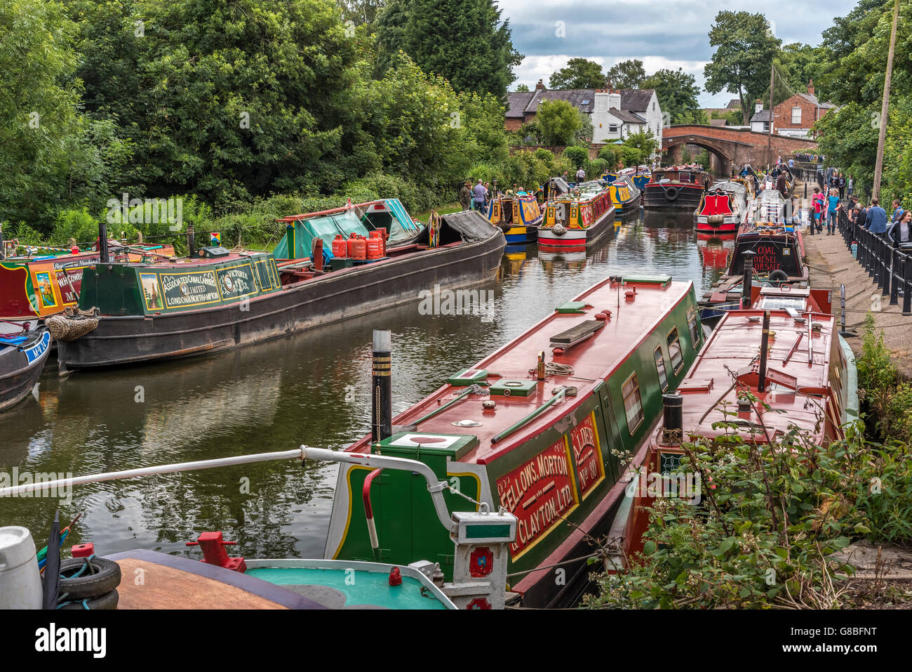 Vintage transport day at Lymm in Cheshire North West England. Parade of canal narrowboats on the Bridgewater. - Stock Image