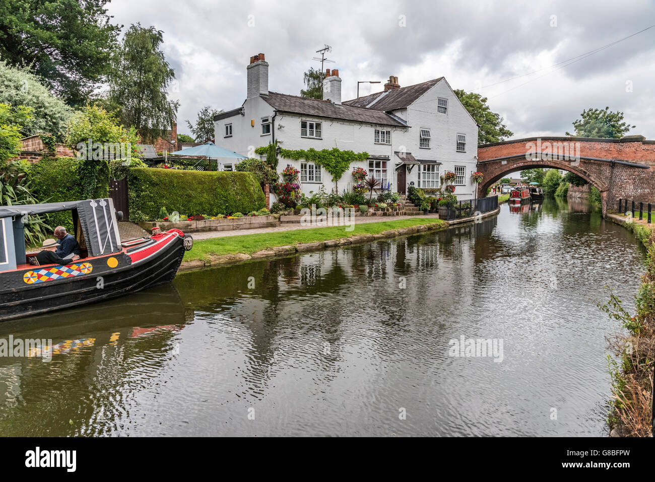 Vintage transport day at Lymm in Cheshire North West England. Parade of canal narrowboats on the Bridgewater. Bridgewater - Stock Image