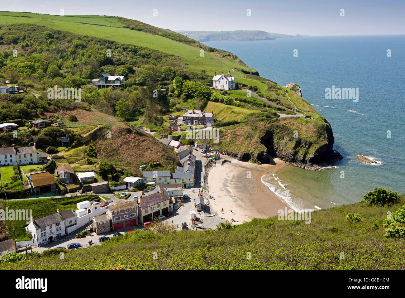 UK, Wales, Ceredigion, Llangrannog, elevated view of village and beach from Lochtyn cliffs - Stock Image
