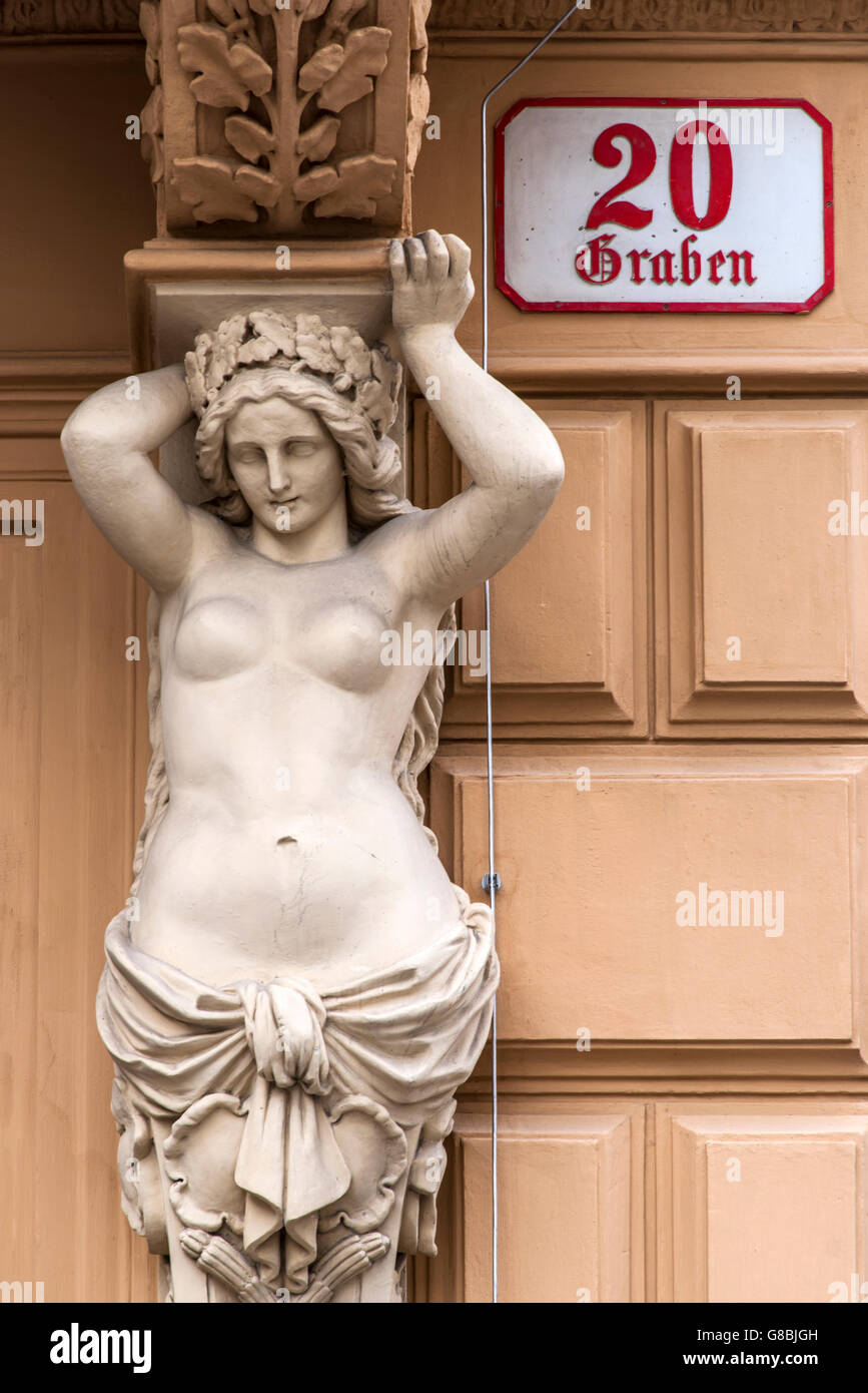 Caryatid sculpted female figure statue on the facade of a building in Graben street, Vienna, Austria - Stock Image