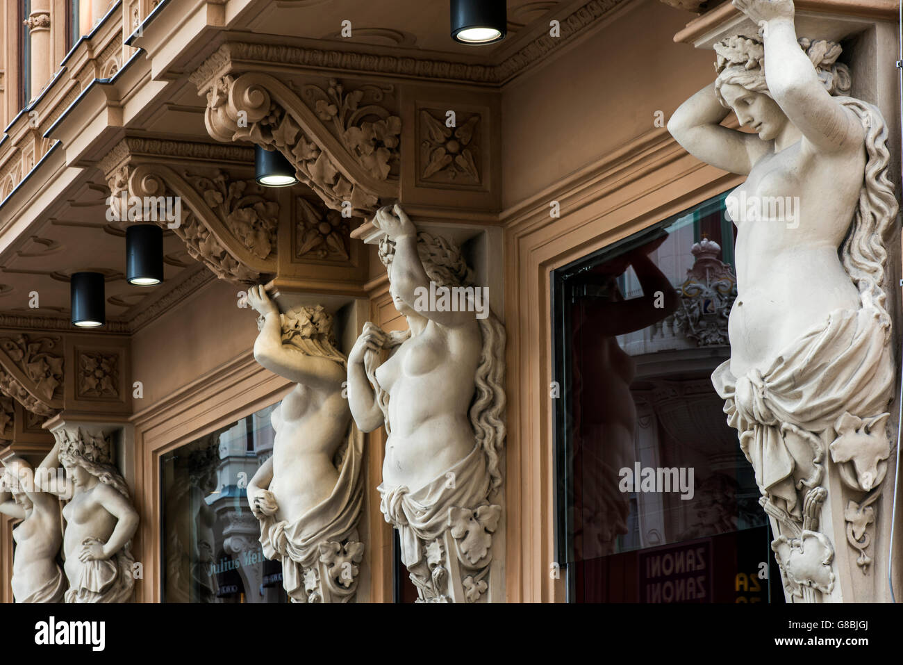 Caryatid sculpted female figure statues on the facade of a building in Graben street, Vienna, Austria - Stock Image