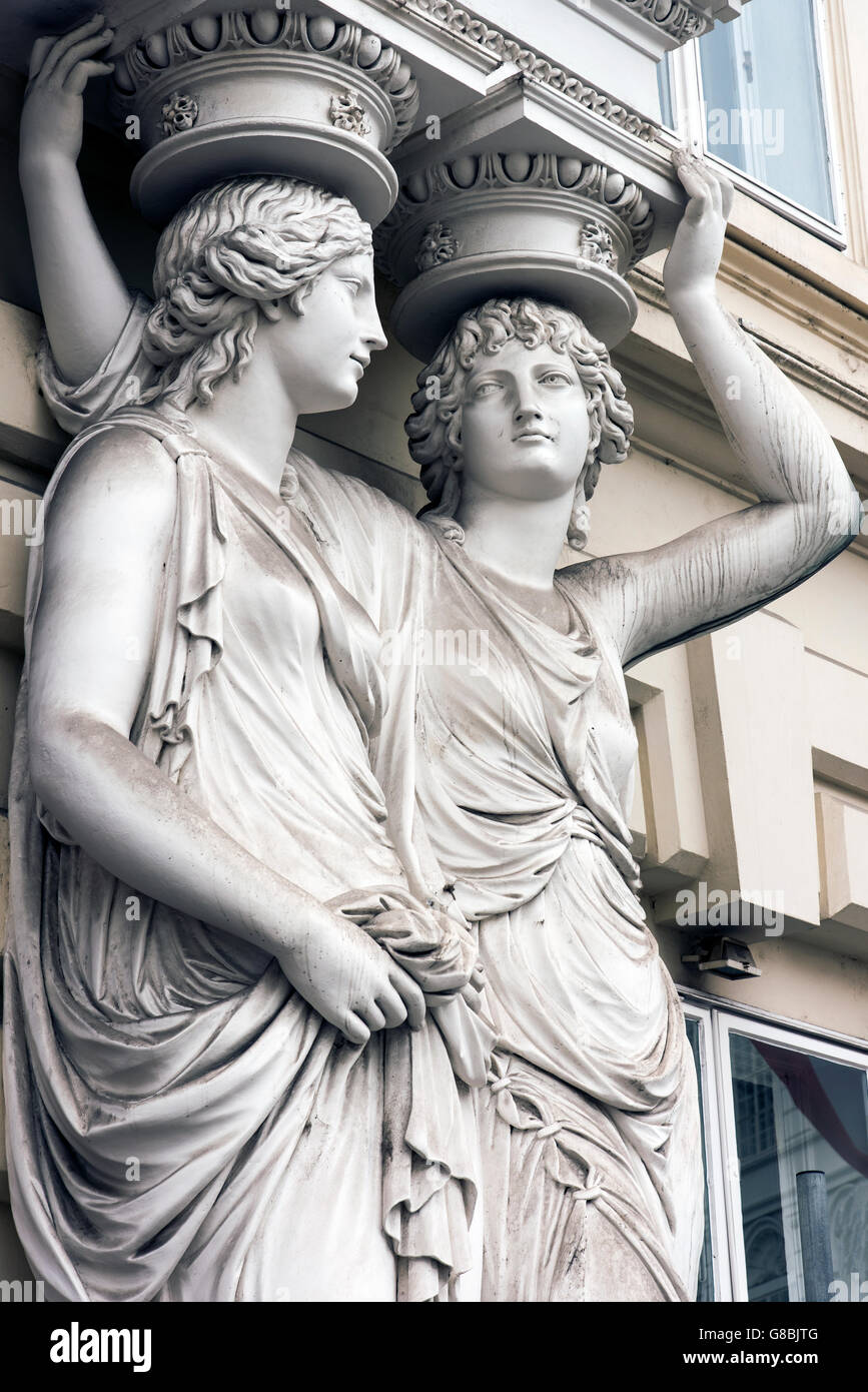 Caryatid sculpted female figure statues in the historic centre, Vienna, Austria - Stock Image