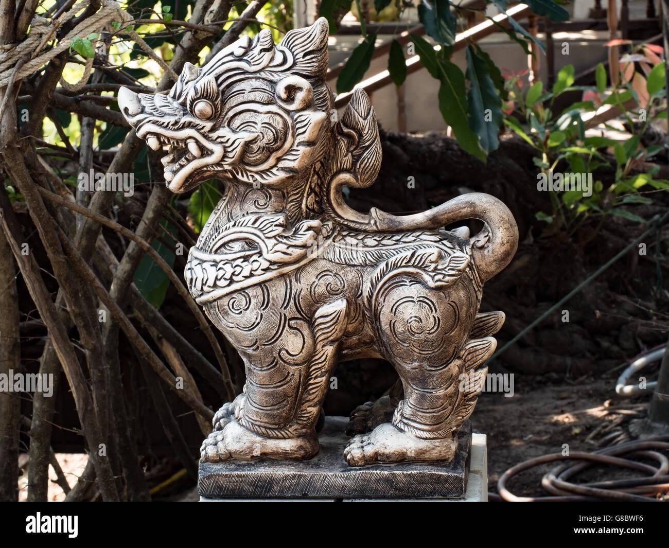 thai,lion,statue,sculpture,molded,figure,statuary,carve,engrave,outdoor,garden,religion - Stock Image