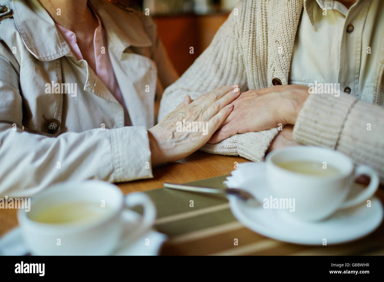 Seniors in cafe - Stock Image