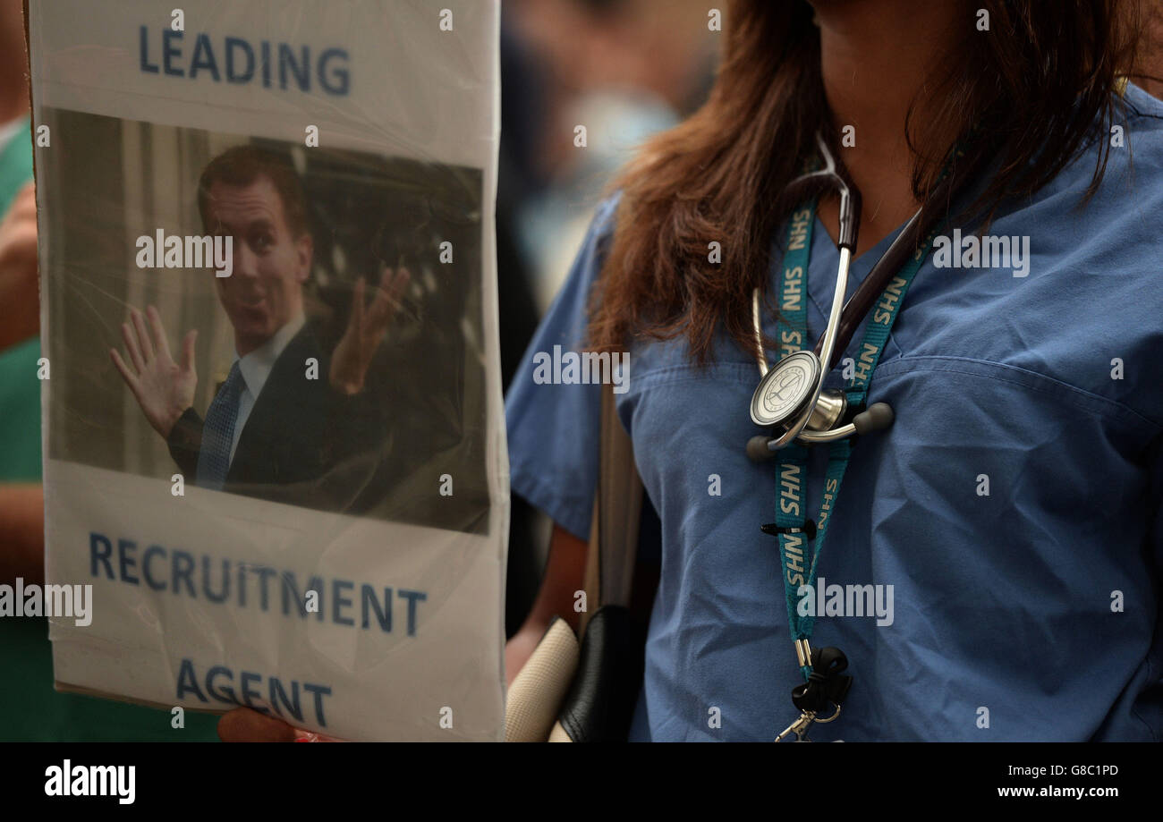 A woman holds a placard during the 'Let's Save the NHS' rally and protest march by junior doctors in London. Stock Photo