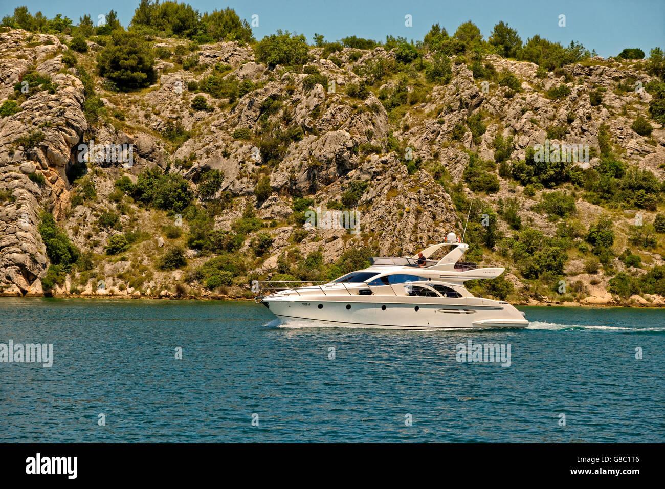 Cruising yacht motoring near Sibenik on the Cikola River, Dalmatia, Croatia. - Stock Image