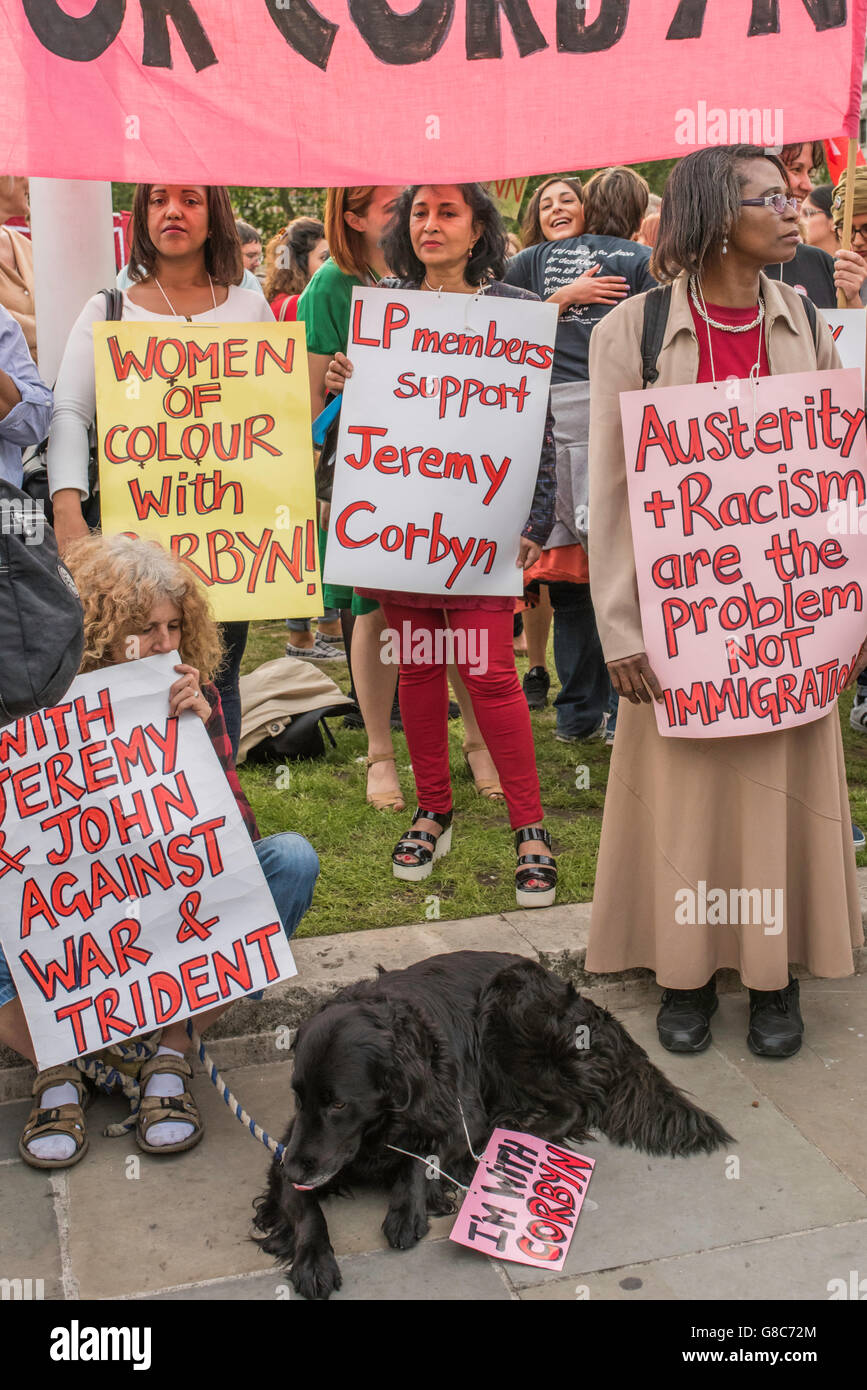 Women supporters of Jeremy Corbyn, the leader of the Labour Party standing with posters demonstrating their support - Stock Image