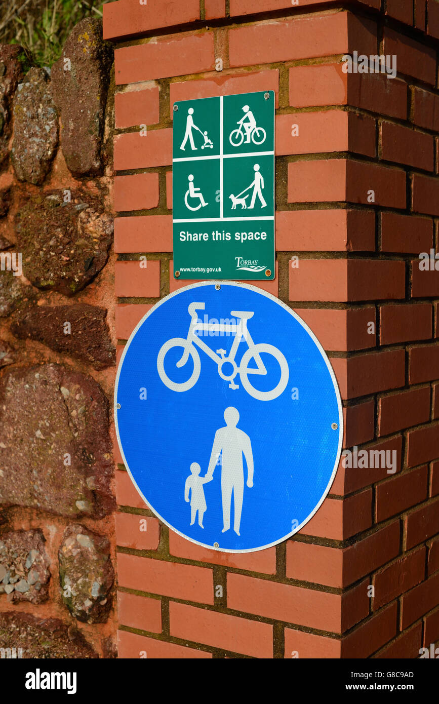 Signs about sharing a public space. - Stock Image
