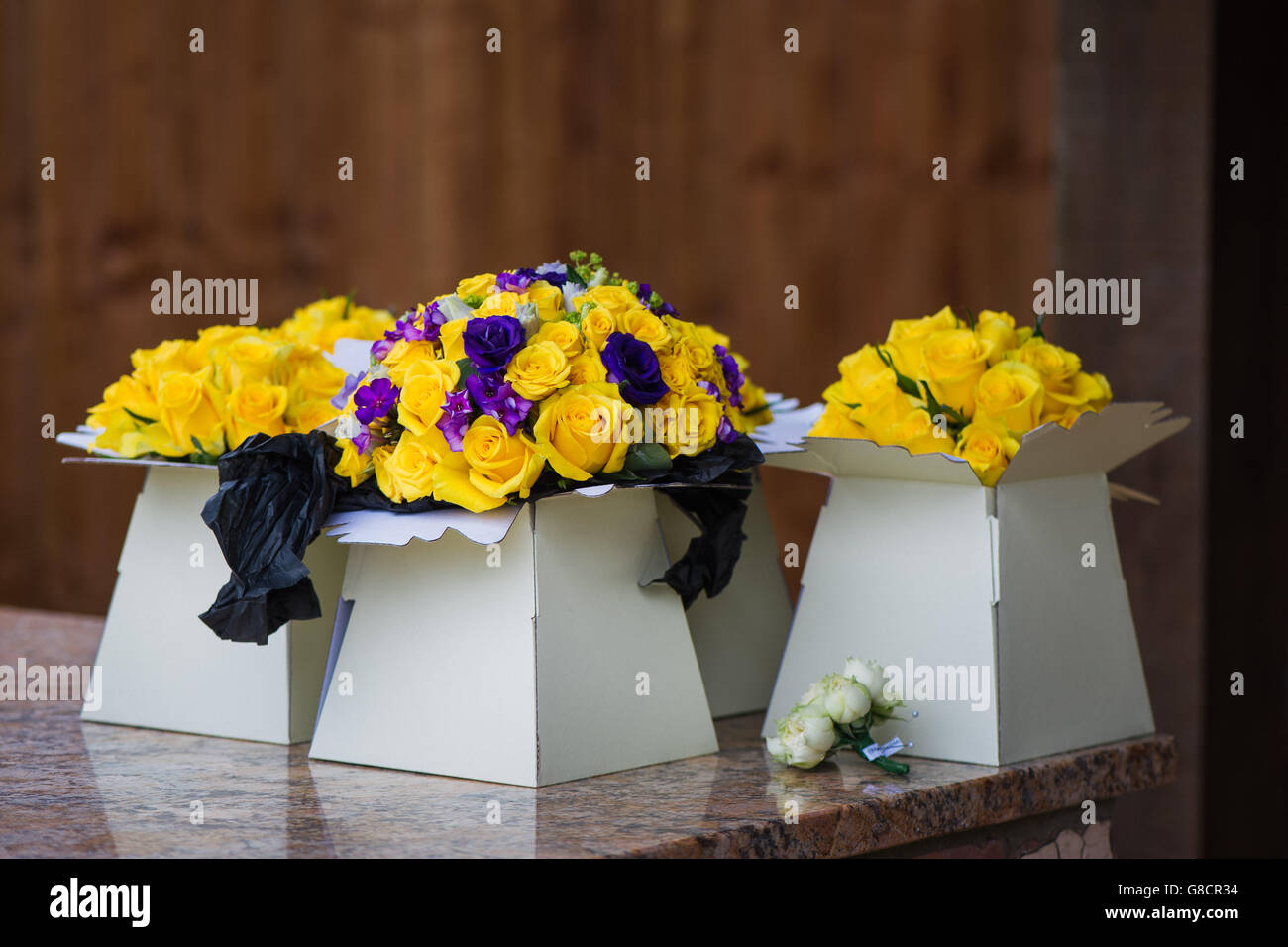Yellow And Purple Bridal Bouquets And Boutonnire For An English