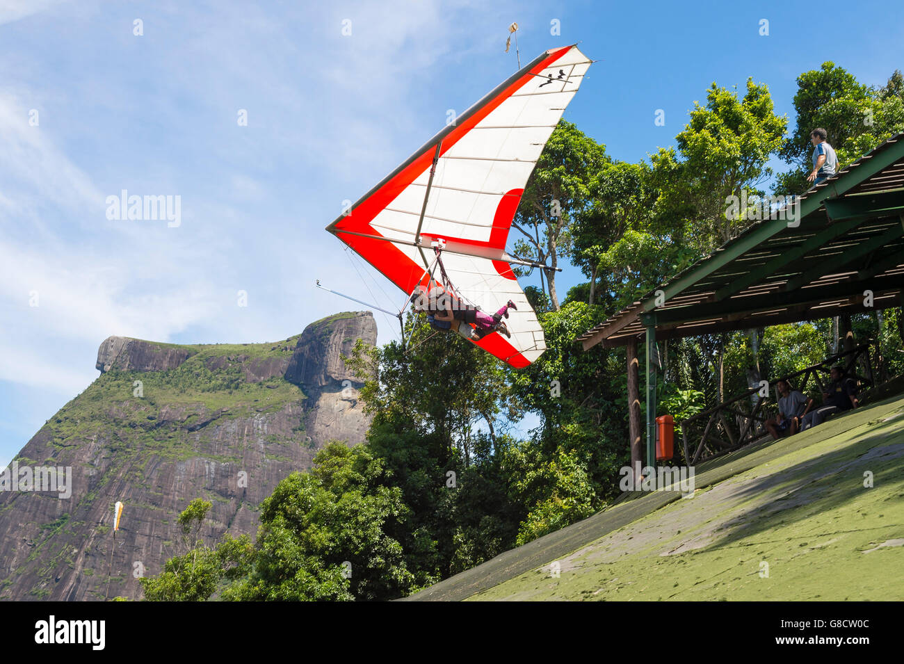 RIO DE JANEIRO - MARCH 22, 2016: A hang gliding instructor takes off with a passenger from Pedra Bonita, in the - Stock Image