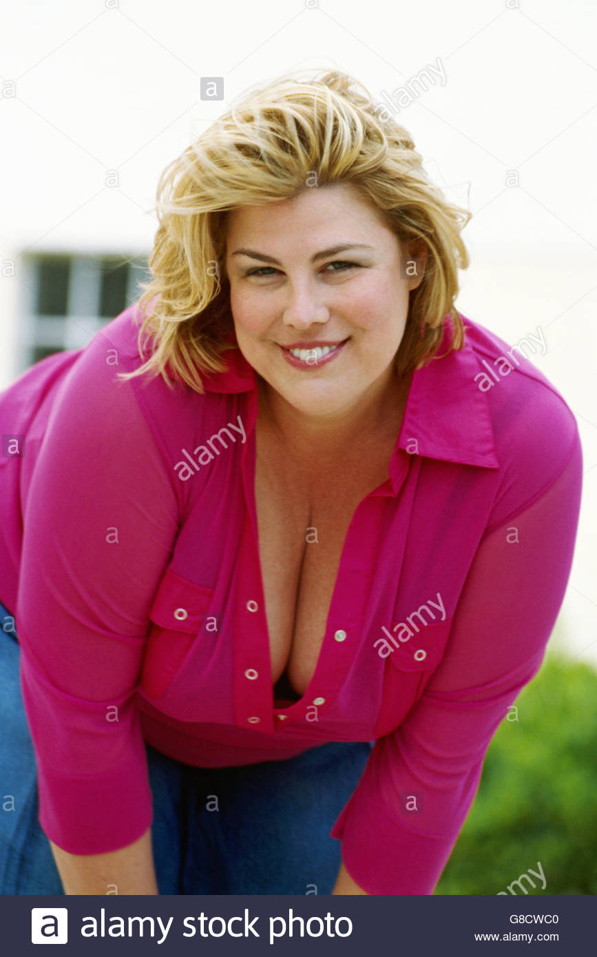 Portrait of overweight woman smiling - Stock Image