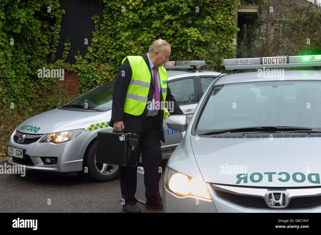 Doctor on call with car. England. UK. Europe - Stock Image