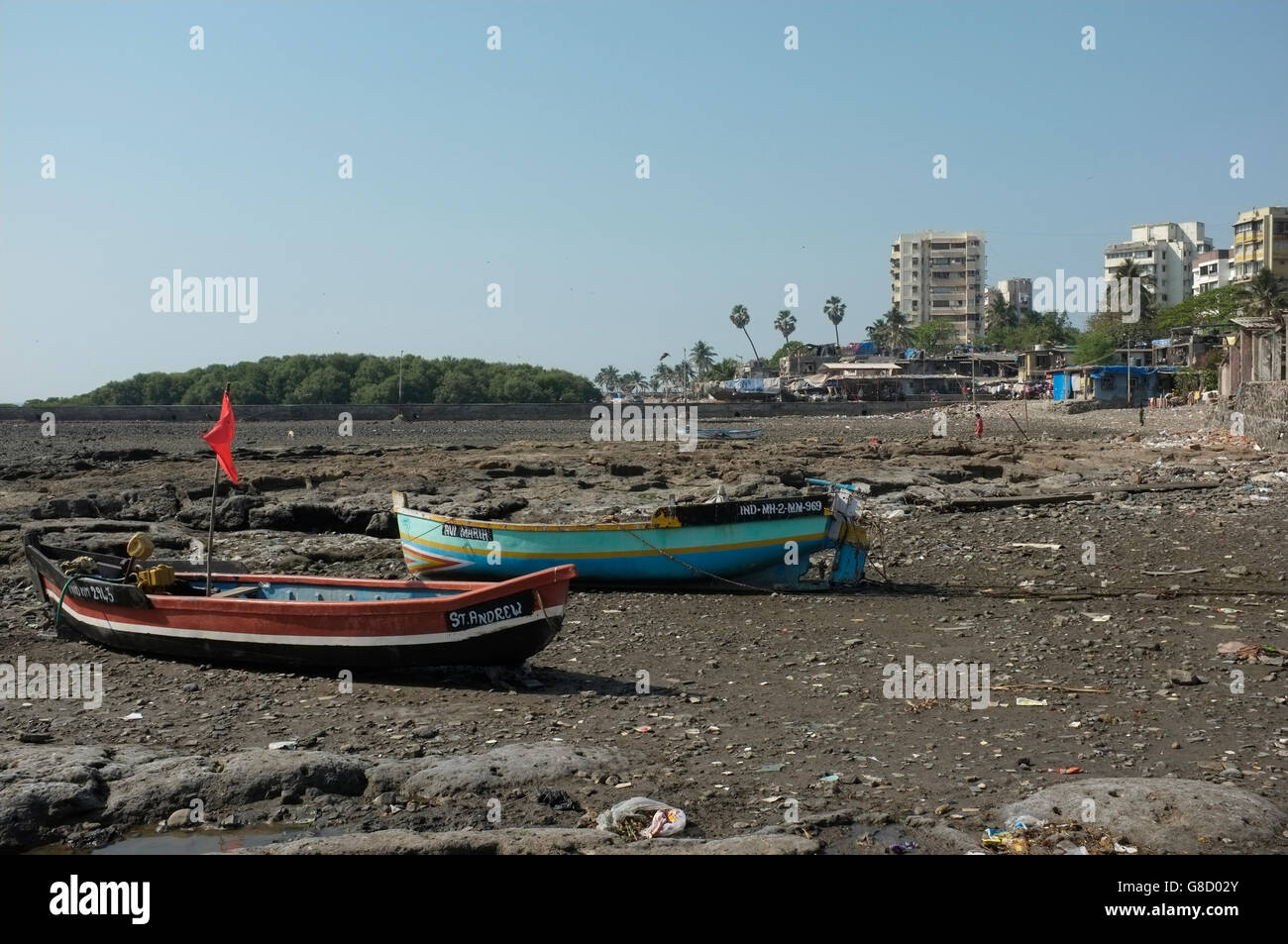 boats on the beach front at the slum area of chimbai village, bandra, mumbai, india - Stock Image
