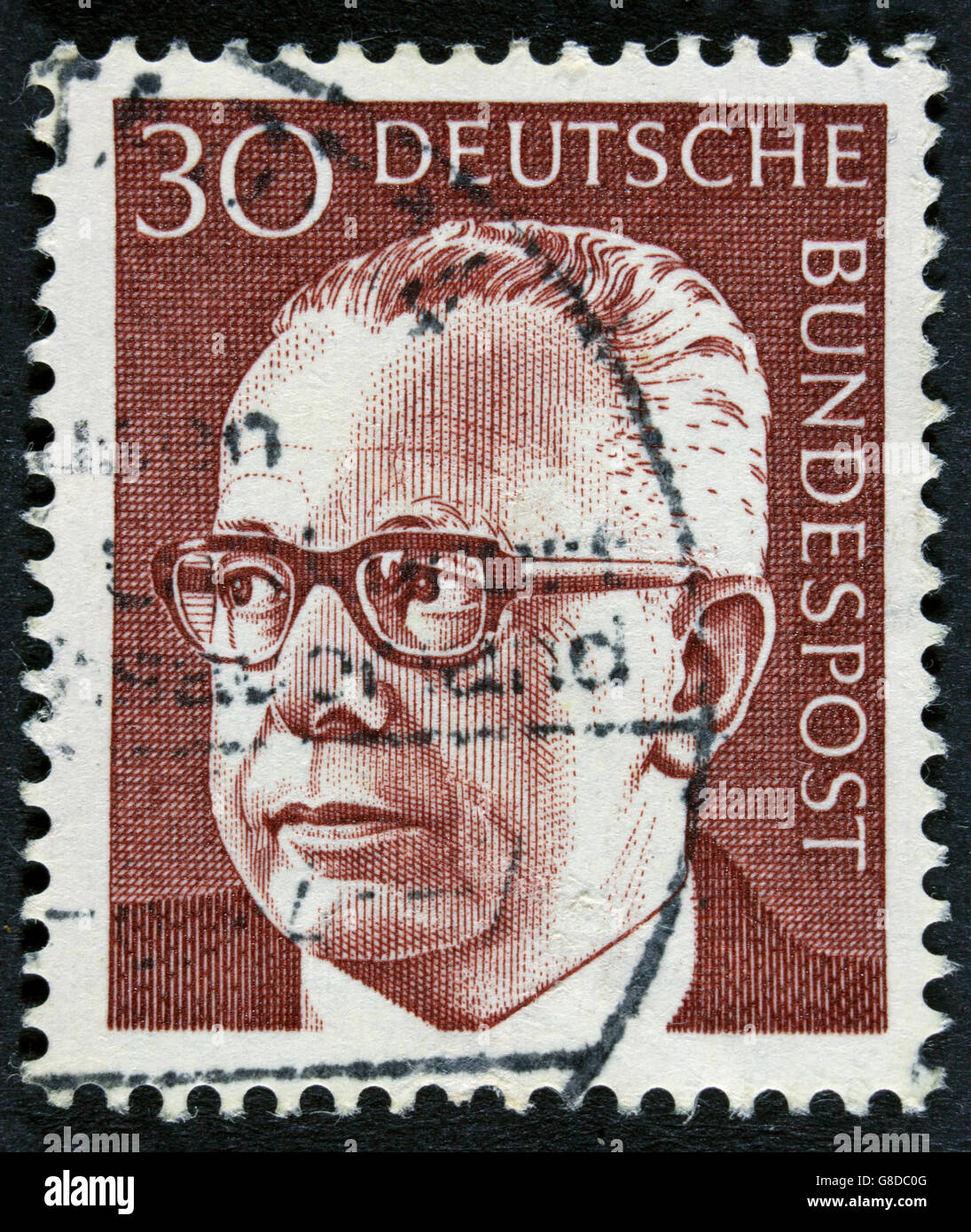 GERMANY - CIRCA 1971: post stamp printed in GDR shows president Gustav Heinemann Stock Photo