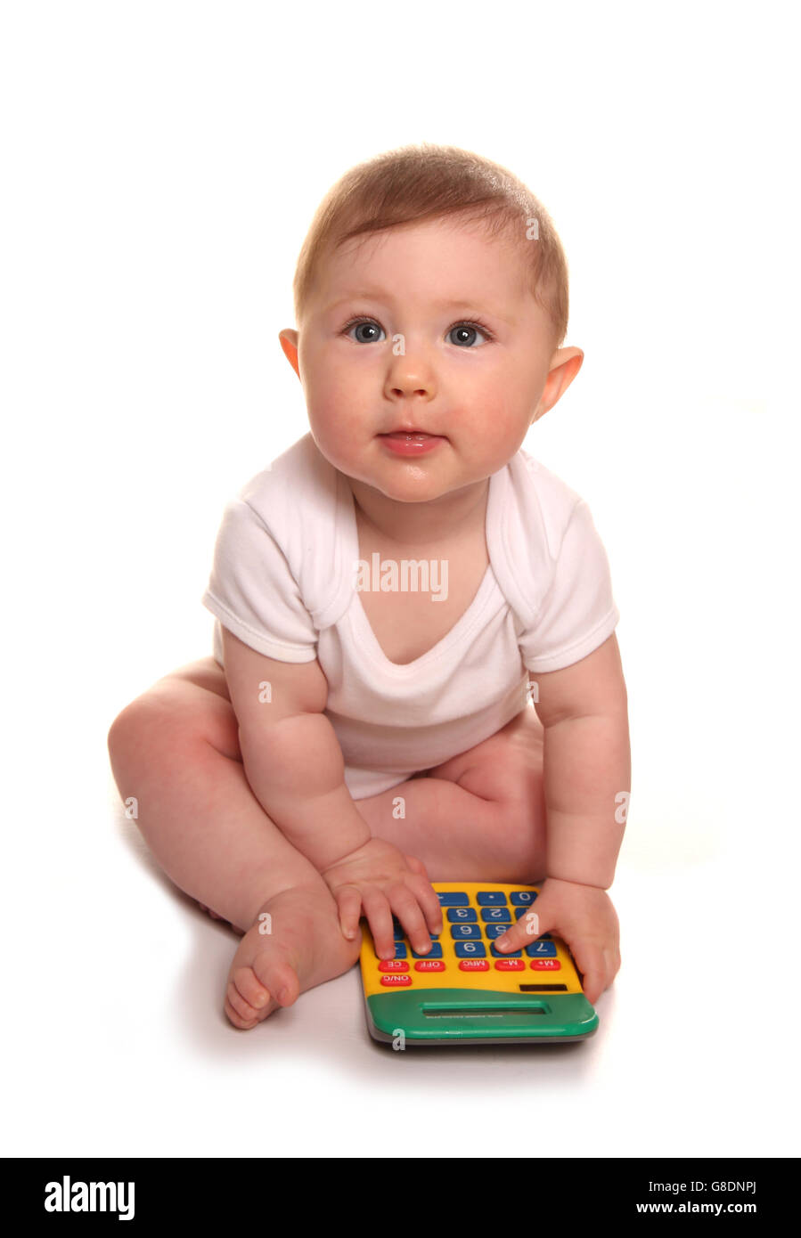 Baby girl playing with a calculator cutout - Stock Image