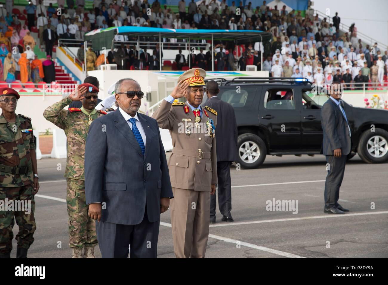 Djiboutian President Ismail Omar Guelleh stands during the playing of the national anthem marking Djibouti Independence - Stock Image