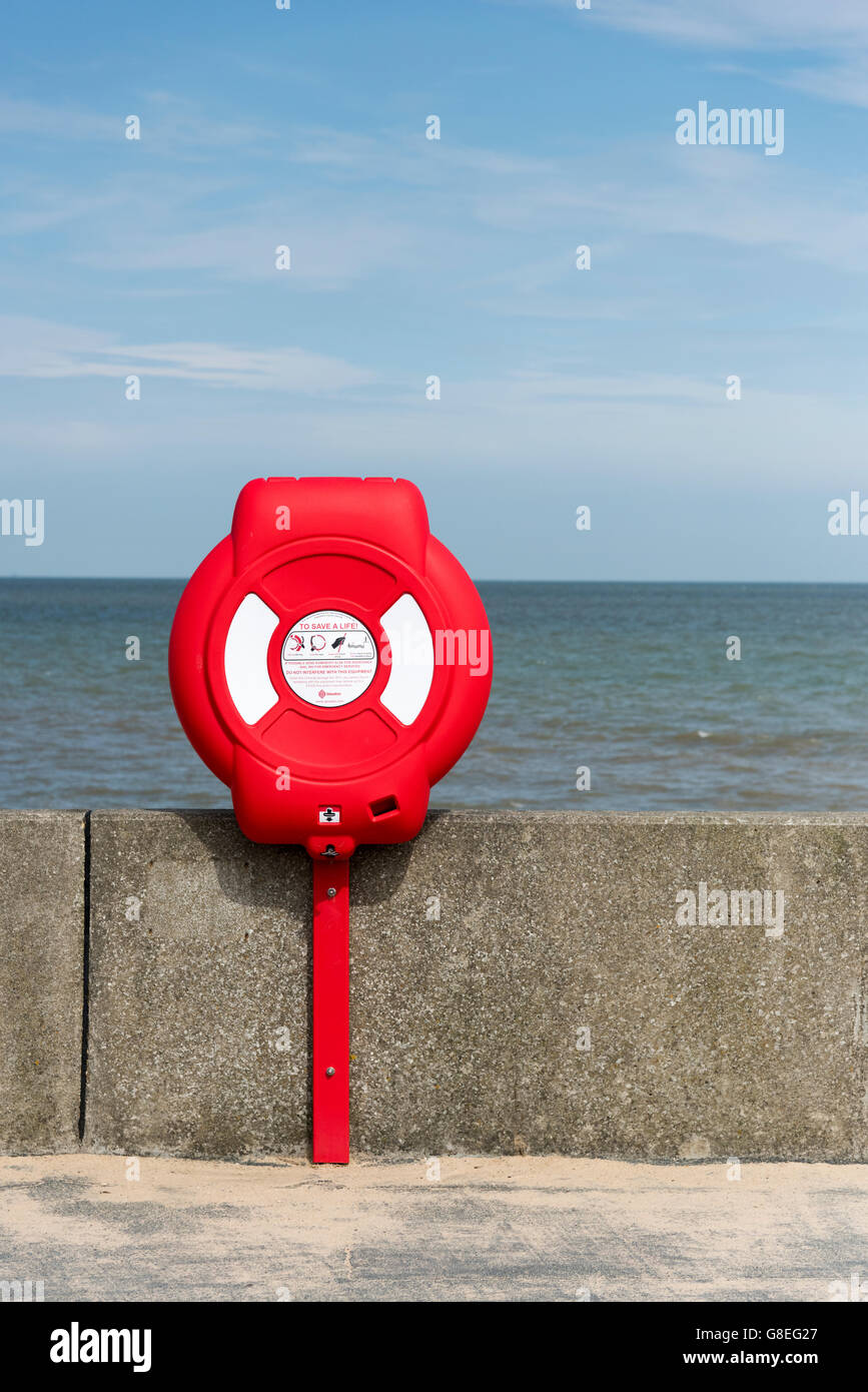 A lifebouy on the sea wall at Walton on the Naze by the north sea coast in the UK Stock Photo