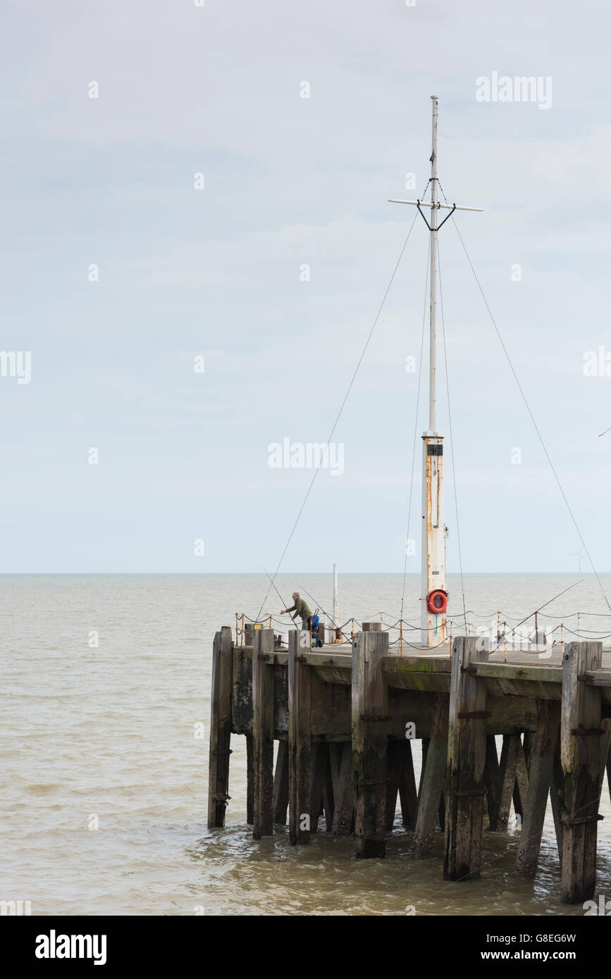 People sea fishing at the end of Clacton Pier UK - Stock Image