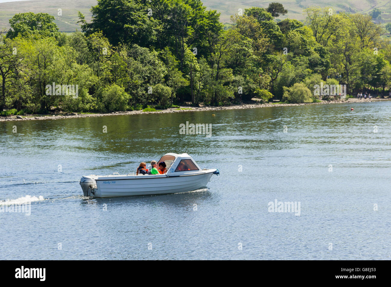 Alaska 500 hire motor boat, with several people board, on Ullswater, the second longest lake in the English Lake - Stock Image