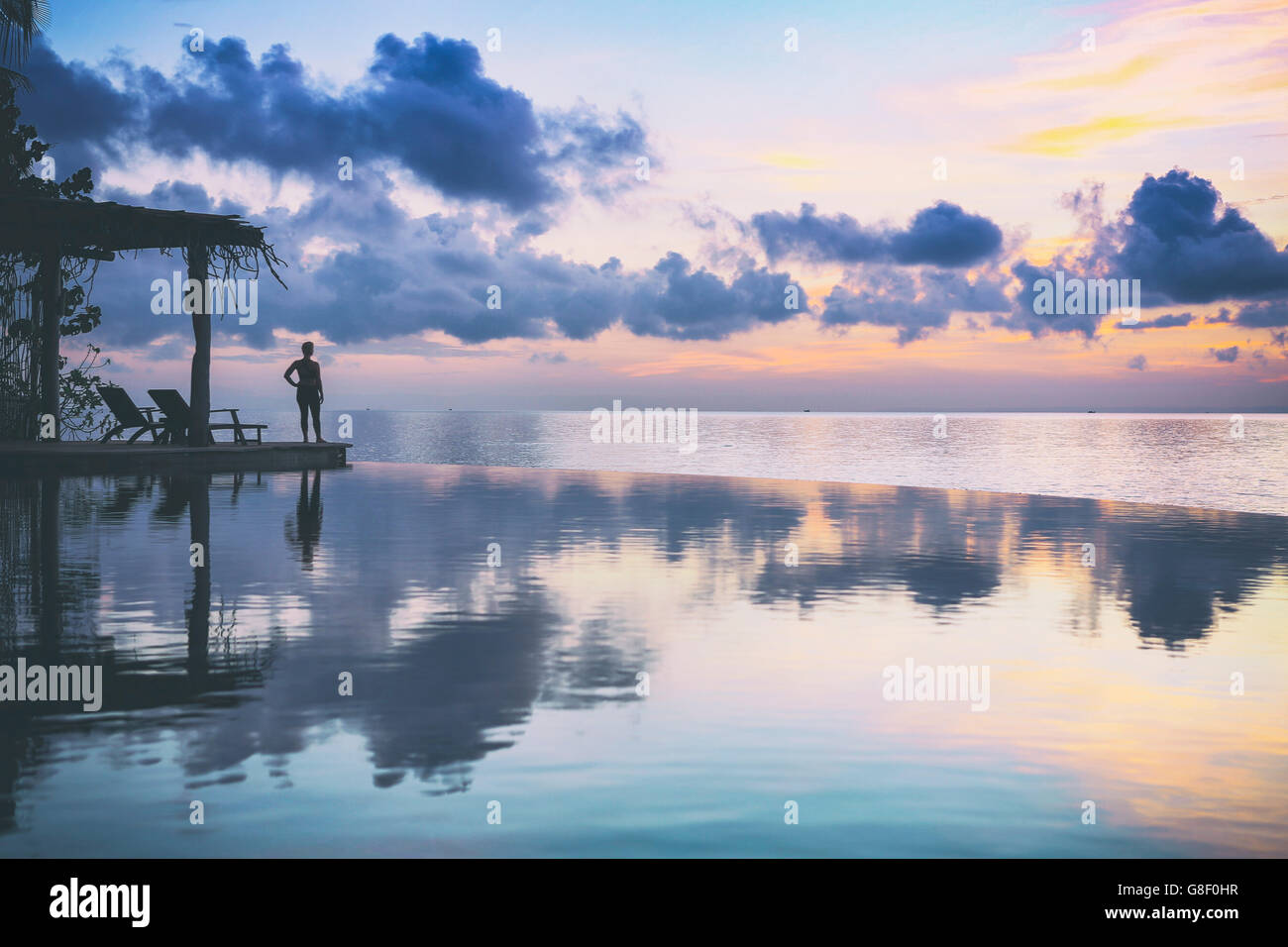 Dawn reflected in an infinity pool - Stock Image