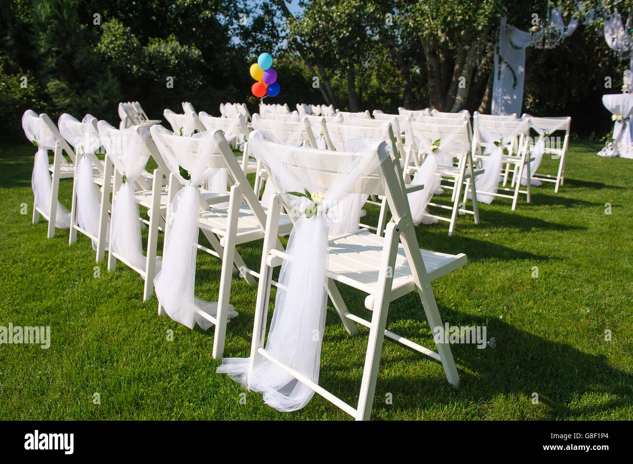 White Decorated Chairs On A Green Lawn Chairs Set In Rows For The Stock Photo Alamy