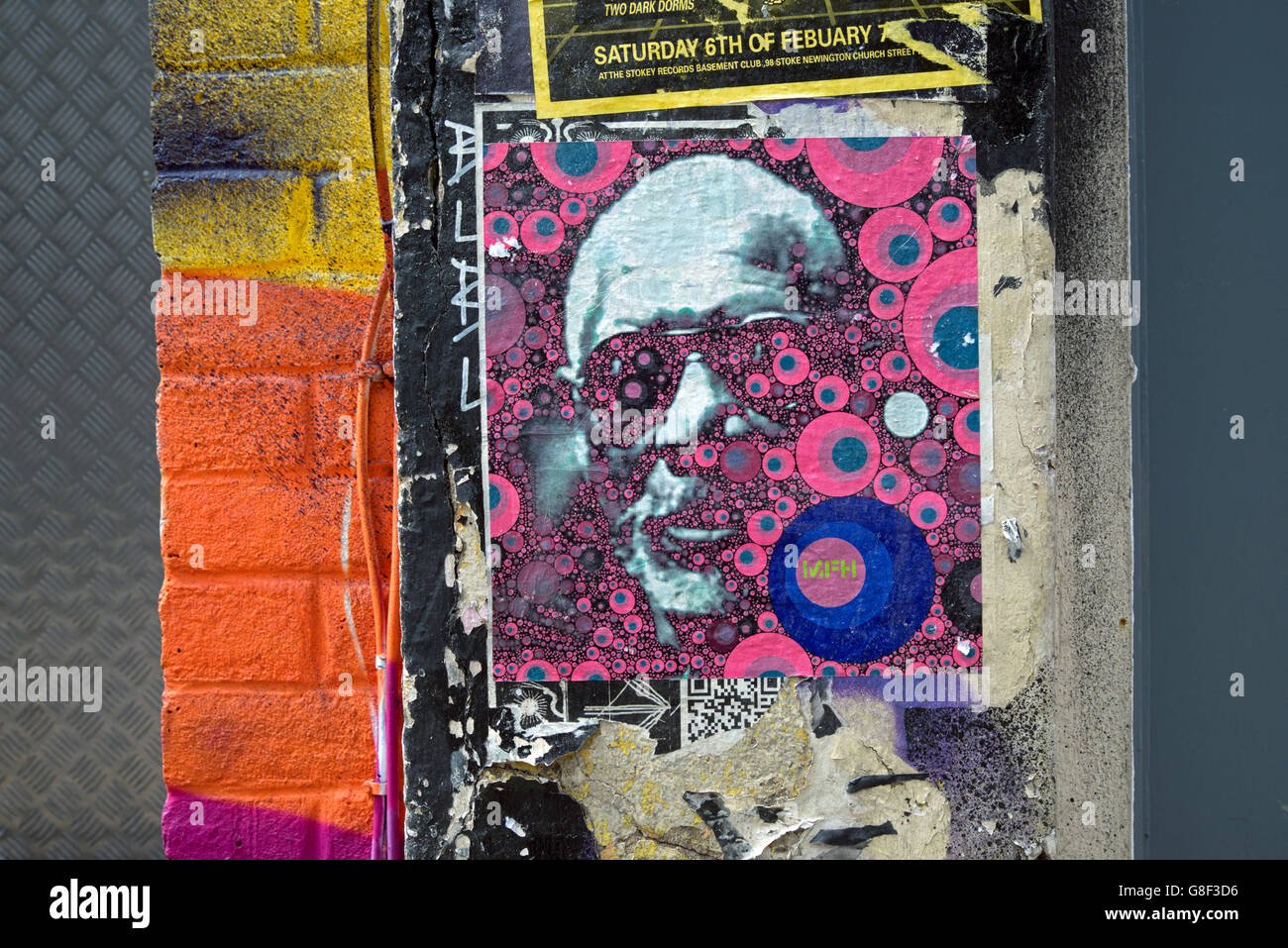 Psychedelic poster on a wall in Chance Street, Shoreditch, East London, UK. - Stock Image