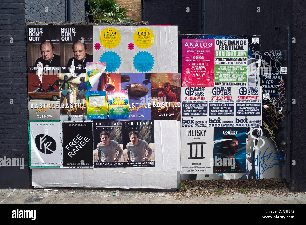 Posters on a wall in Chance Street , Shoreditch, East London, UK. - Stock Image