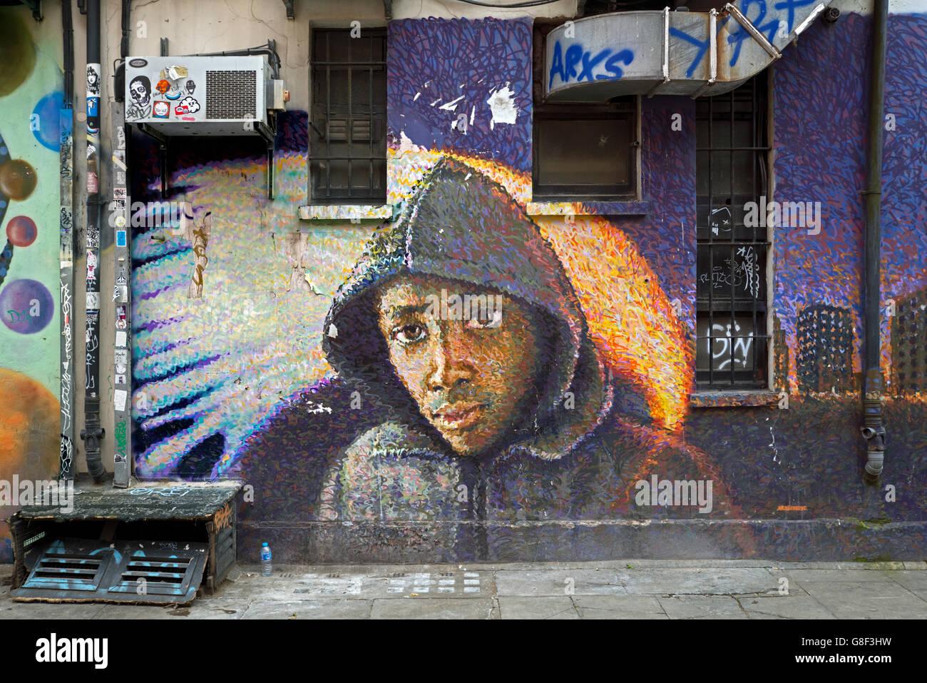 Portrait by street artist  James Cochran  in Whitby Street, Shoreditch, East London, UK. - Stock Image