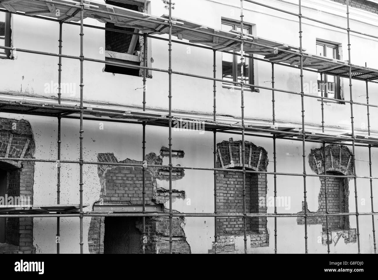 Scaffolding around historic building during the renovation - Stock Image