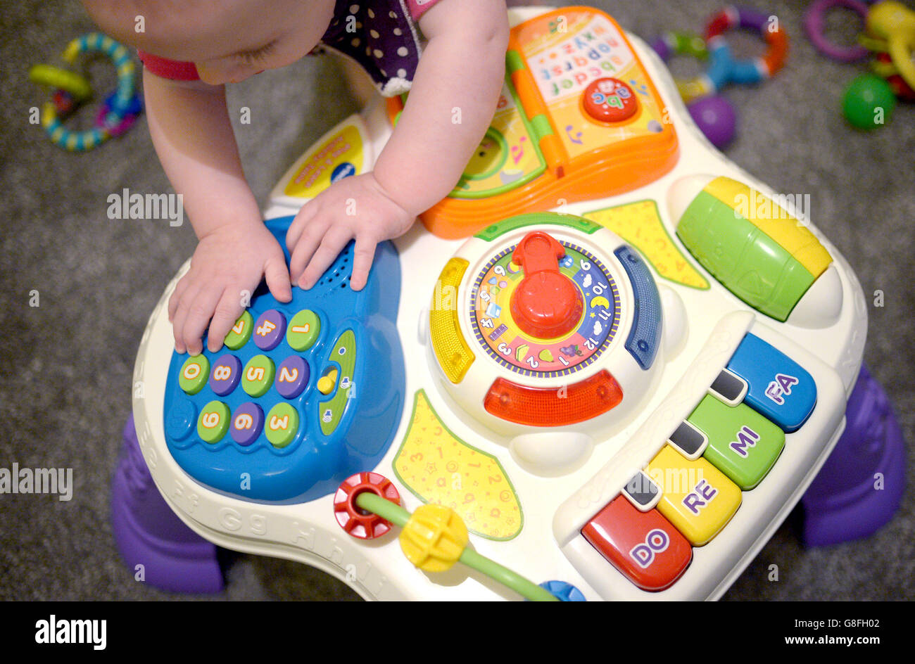 Toys For A 9 Month Old : Posed by model a month old girl plays with pre school toys stock