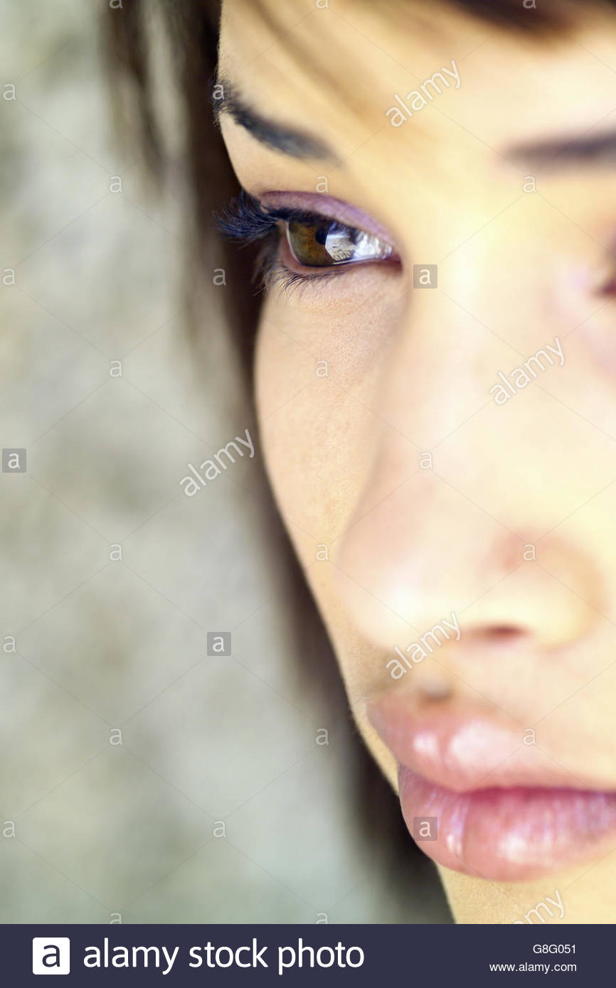 Extreme close up of woman's face - Stock Image