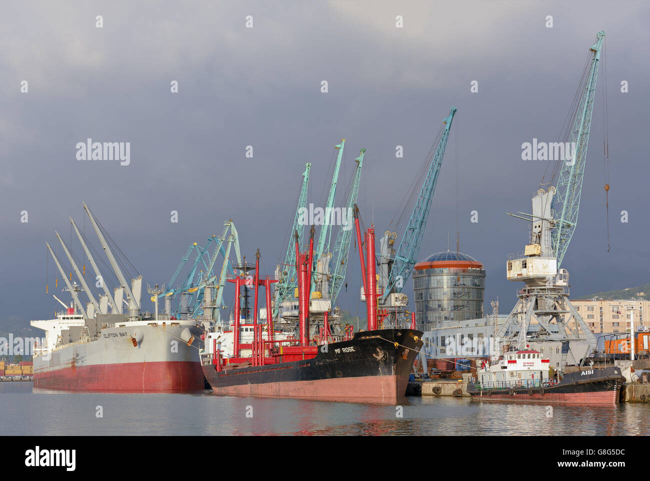 Batumi industrial sea port with ships and cranes, Black Sea harbour - Stock Image