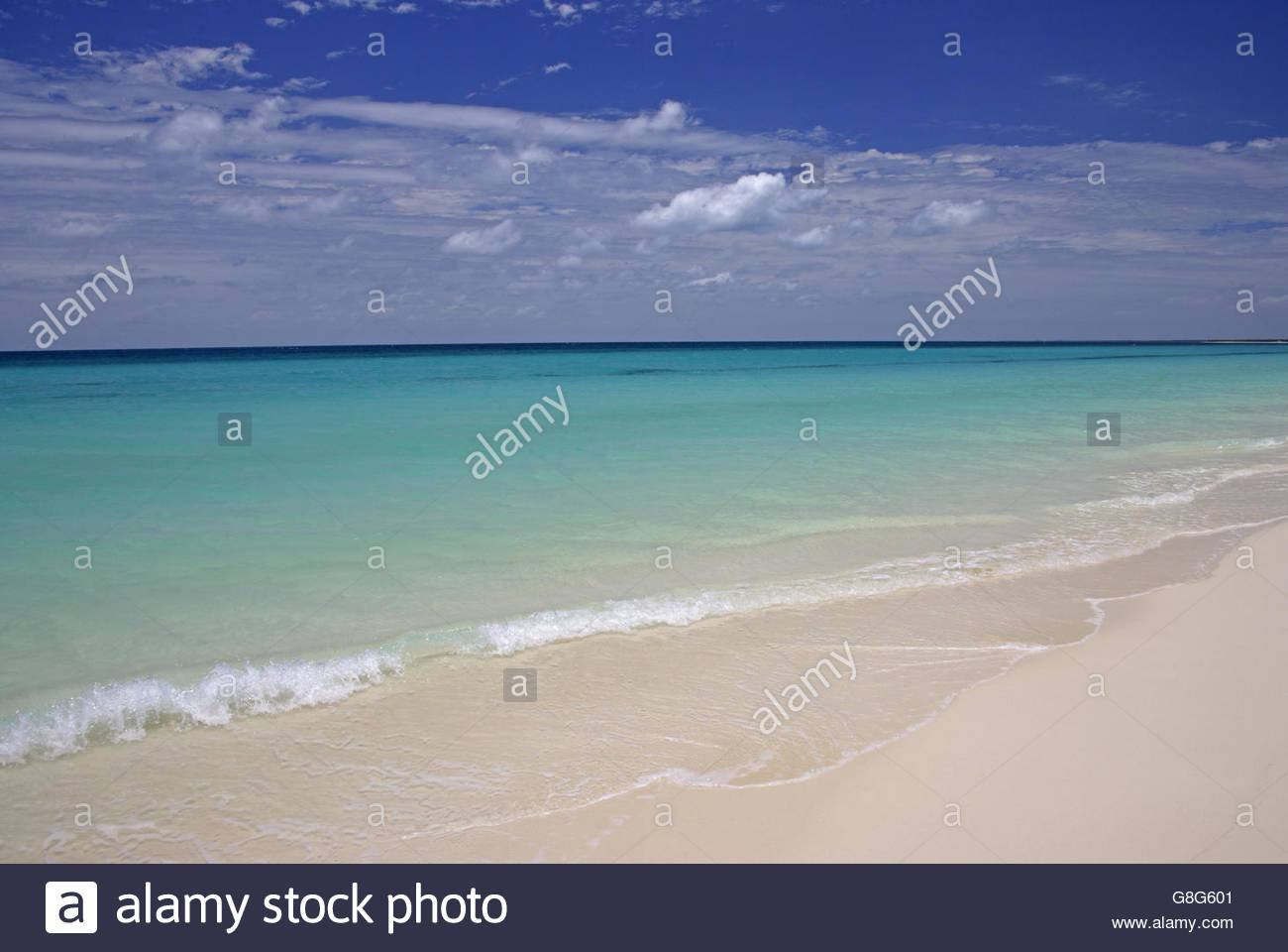 White Beach and turquoise ocean of Ouvea Island, Loyalty Islands, New Caledonia, Overseas Territory of France - Stock Image