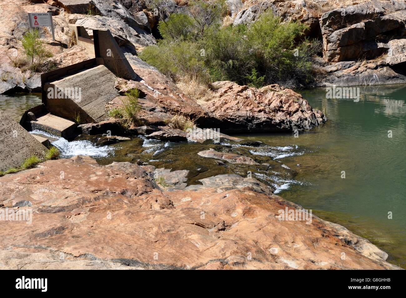 Small dam at the Serpentine Falls with granite rock formations in Serpentine National Park in Serpentine, Western - Stock Image