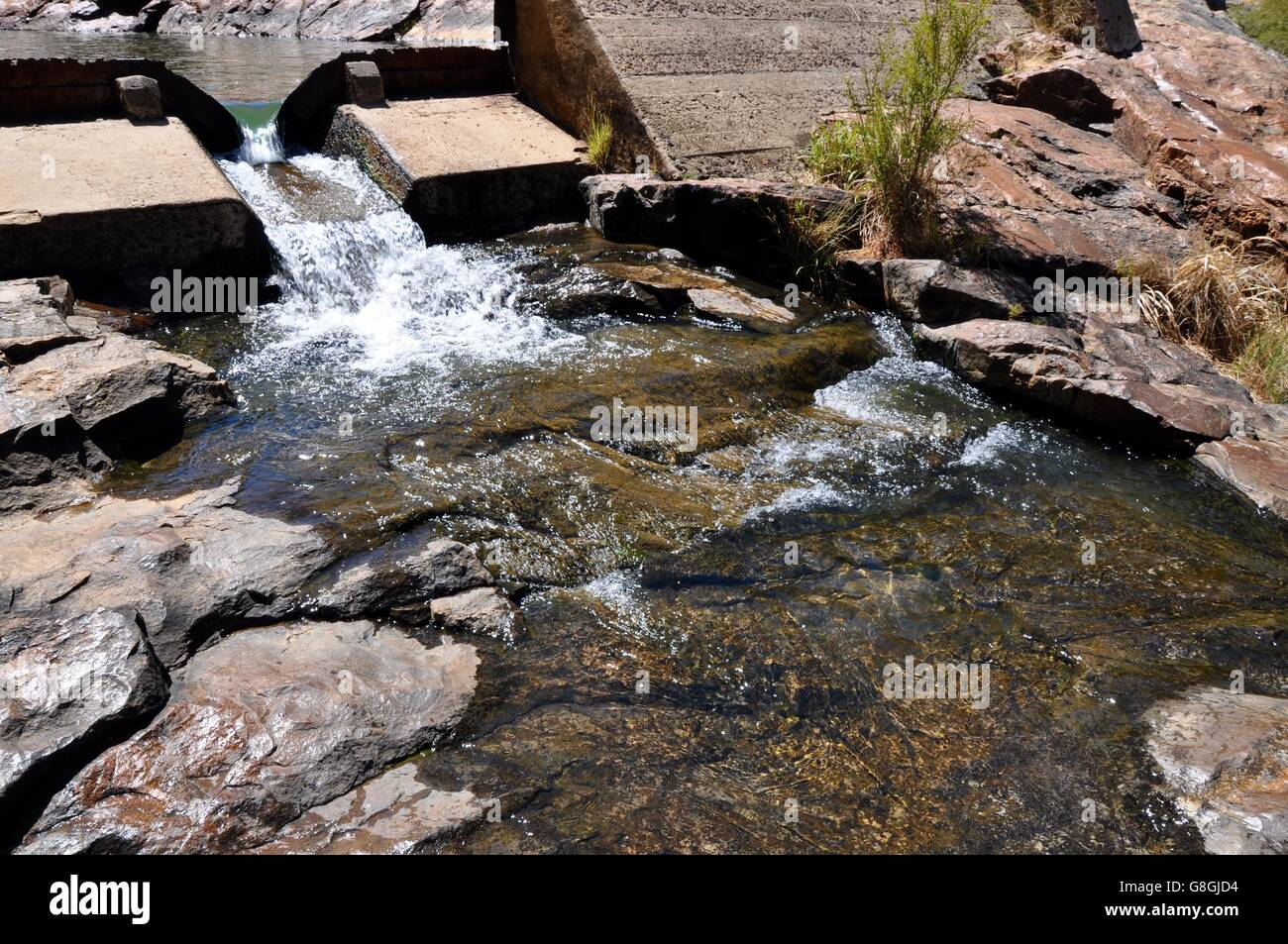 Spillway at the Serpentine Falls flowing into the granite rock pools in Serpentine, Western Australia. - Stock Image