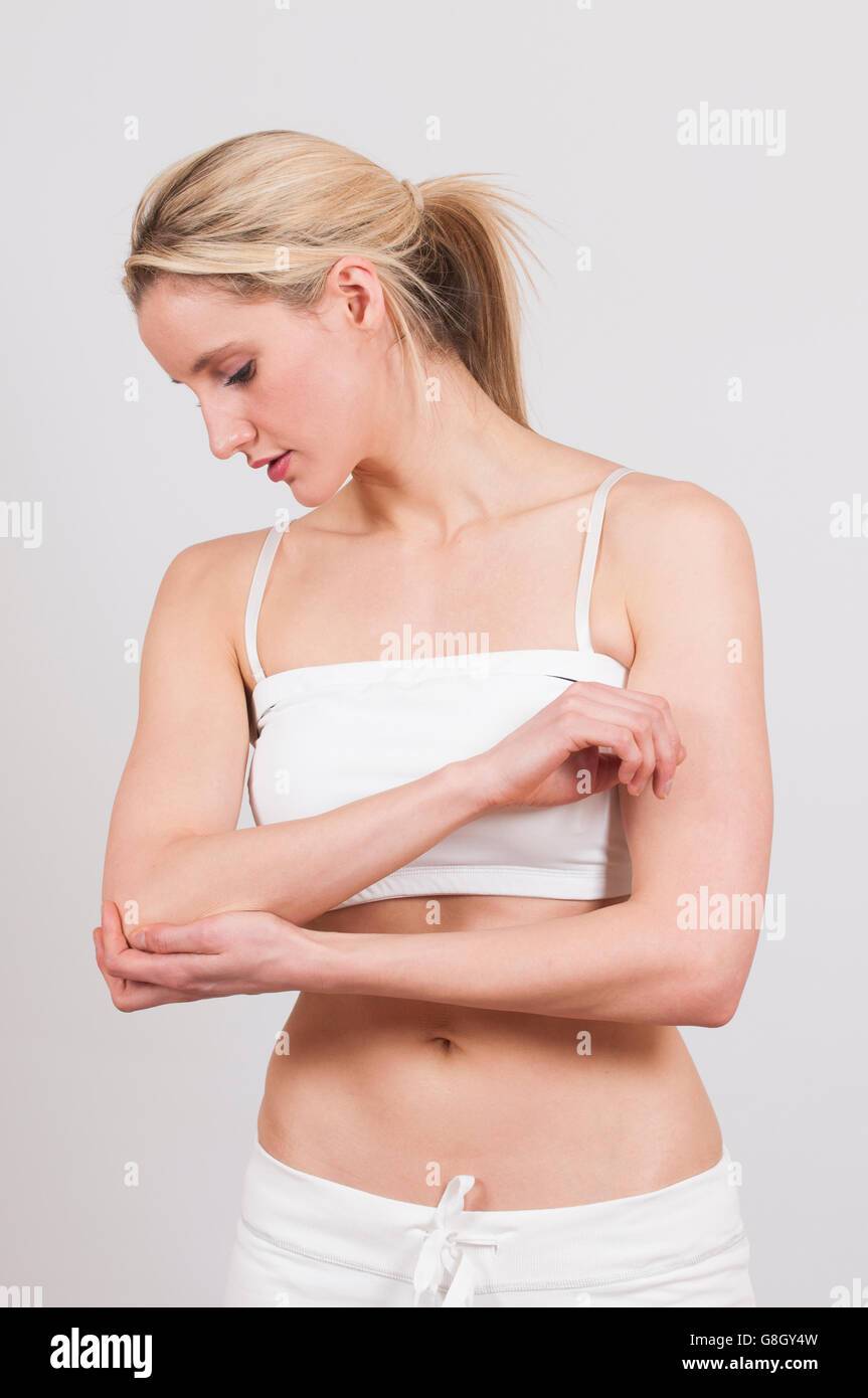 Woman feeling pain in her elbow - Stock Image