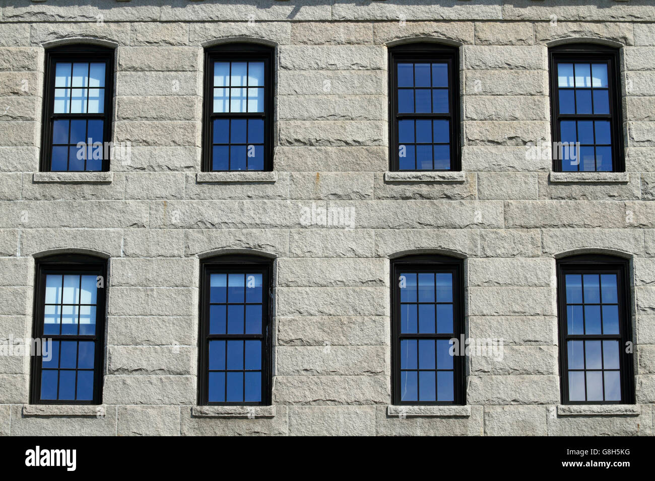 Window panes in a gentrified factory on Commercial Street, Portland, Maine, USA - Stock Image