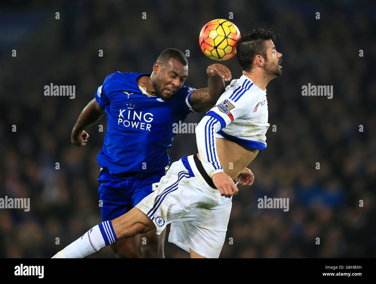 Leicester City's Wes Morgan (left) and Chelsea's Diego Costa battle for the ball during the Barclays Premier League match at The King Power Stadium, Leicester. Stock Photo