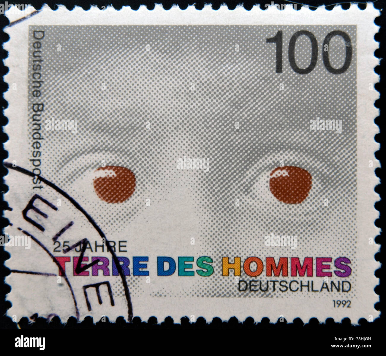 GERMANY - CIRCA 1992: A stamp printed in Germany dedicated to international federation 'terre des hommes' - Stock Image