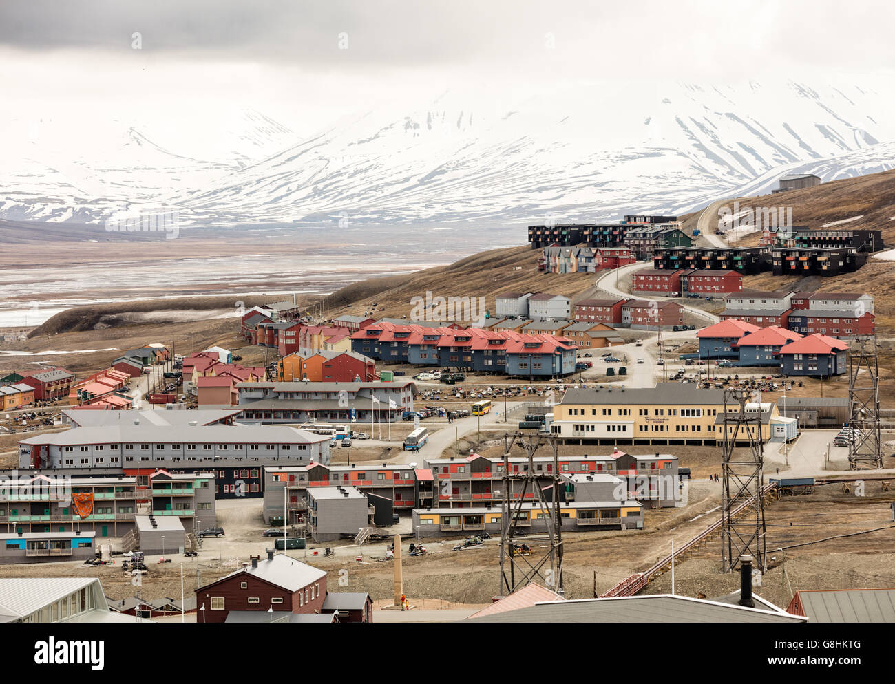 Multicolored houses pn Adventfjorden in the Arctic village of Longyearbyen, largest town in the Svalbard Archipelago - Stock Image