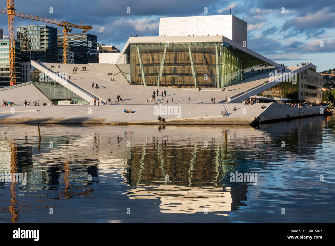 Oslo Opera House reflected in the bay at sunset Stock Photo