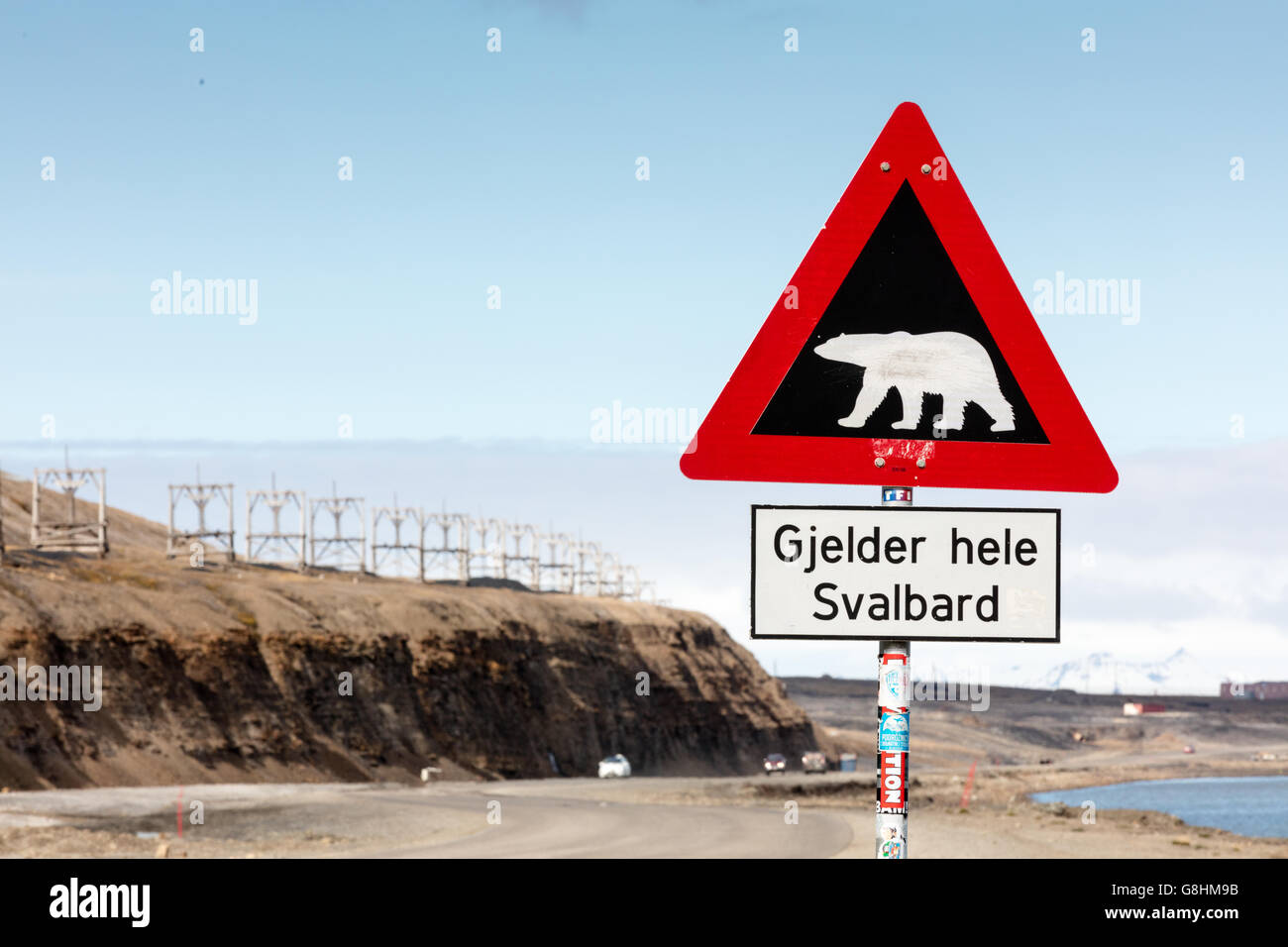 Roadside caution warning of Polar Bear risk throughout all Svalbard. - Stock Image