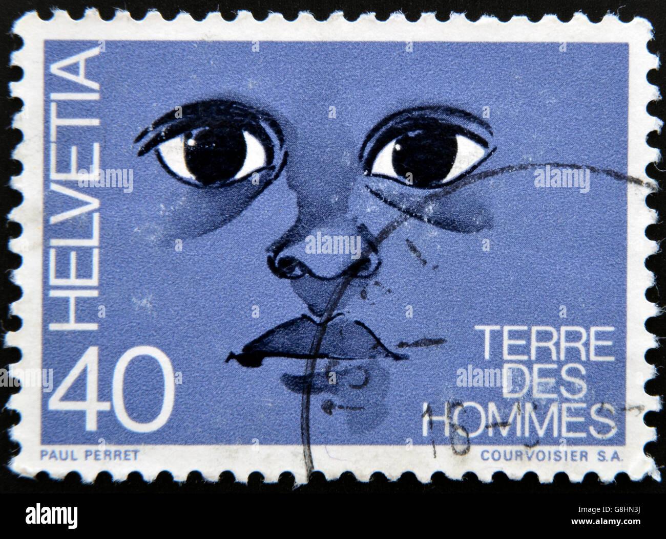 SWITZERLAND - CIRCA 1992: A stamp printed in Switzerland dedicated to international federation 'terre des hommes' - Stock Image