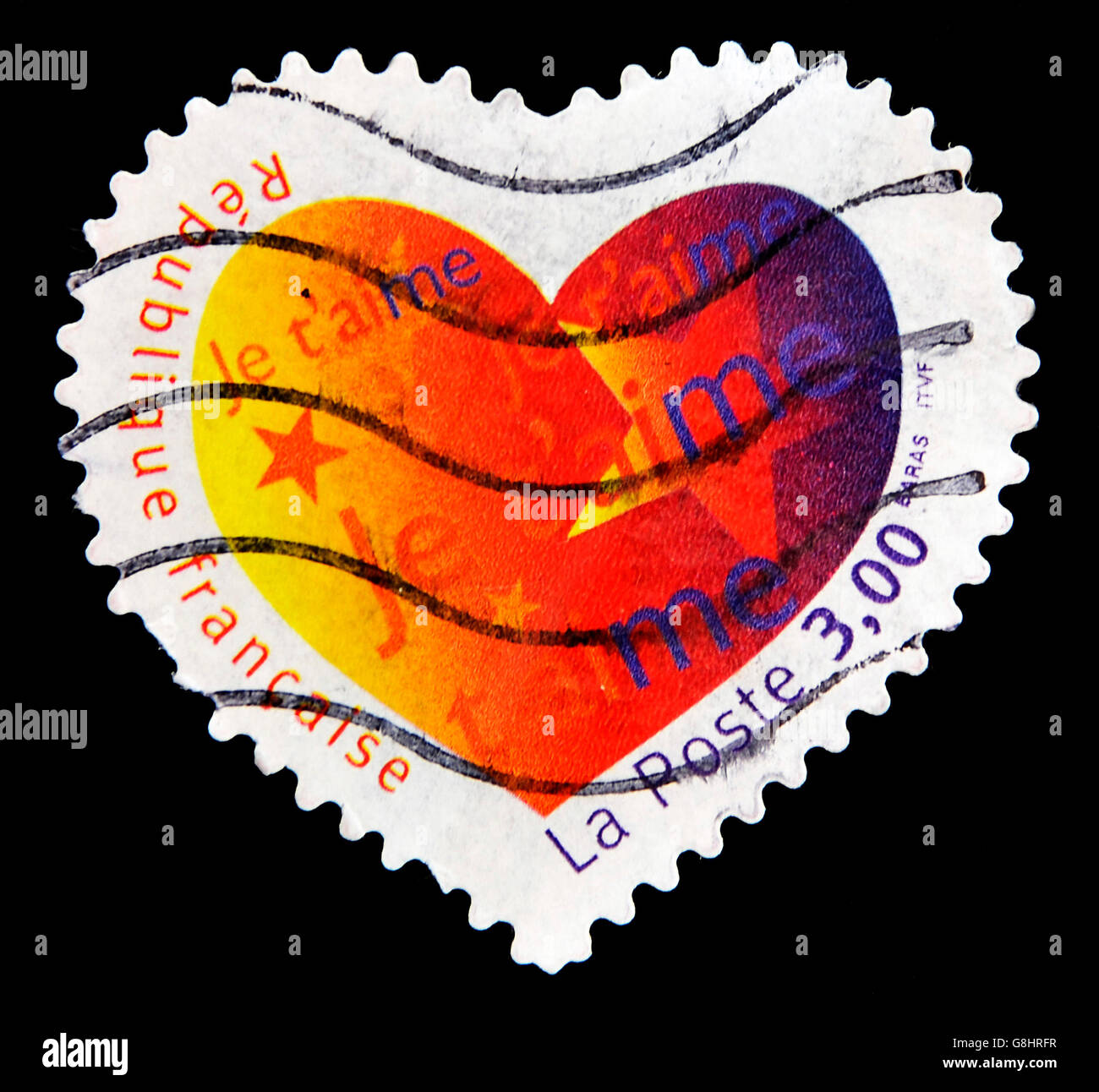 FRANCE - CIRCA 2003: A Heart Shaped Stamp with the word love you in French, circa 2003 - Stock Image
