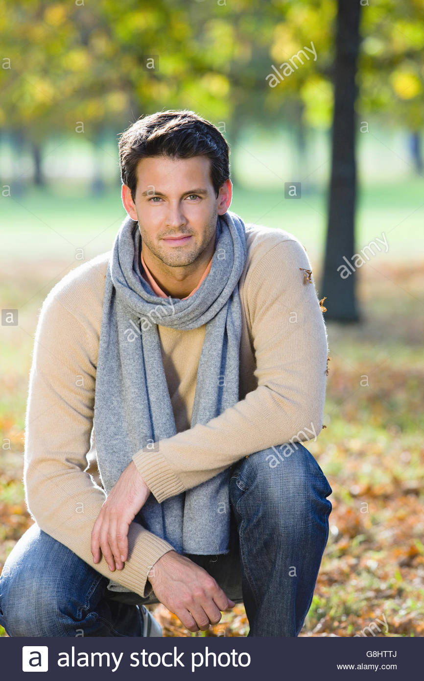 Mid adult man in autumn forest - Stock Image