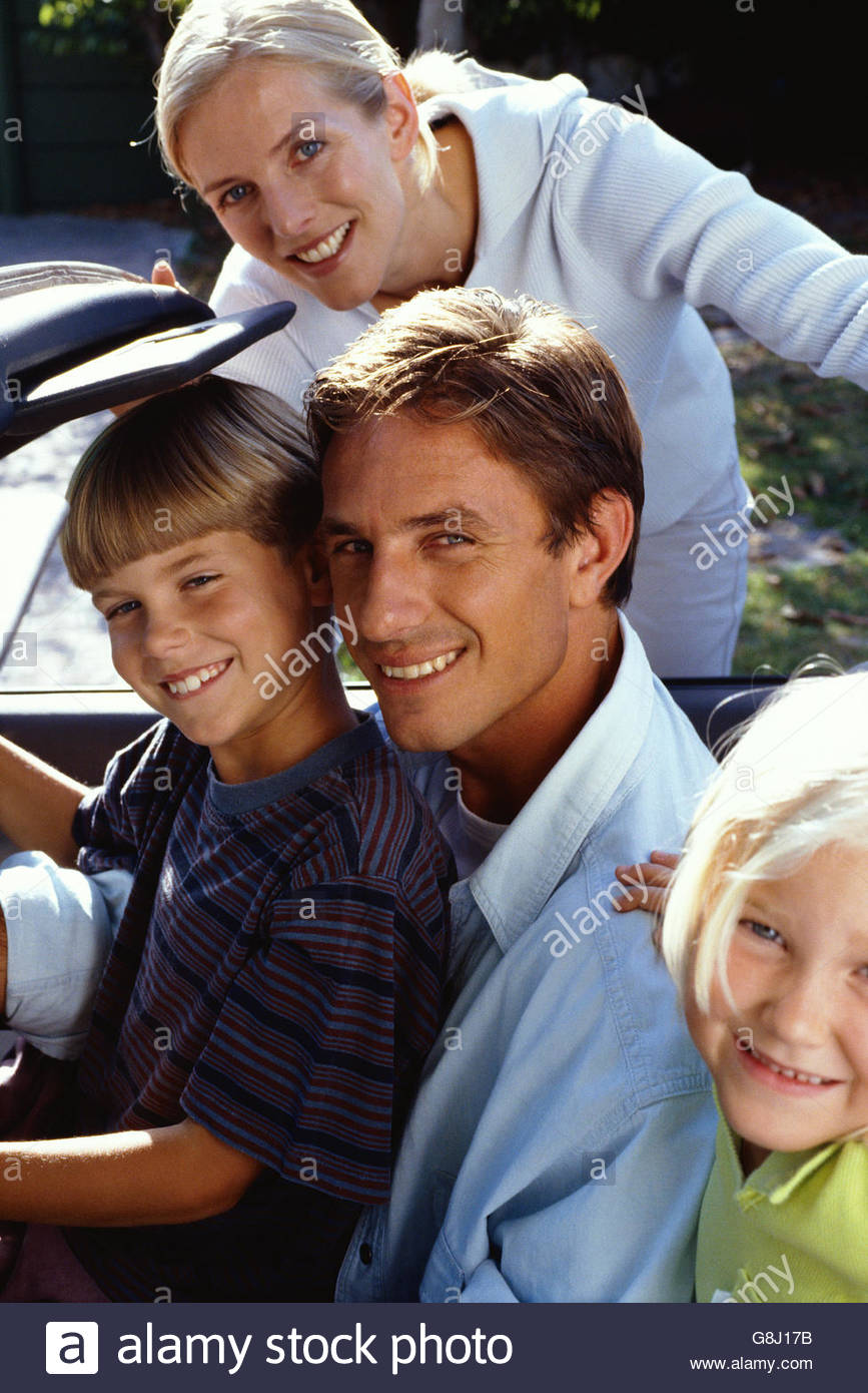 Family in convertible car - Stock Image