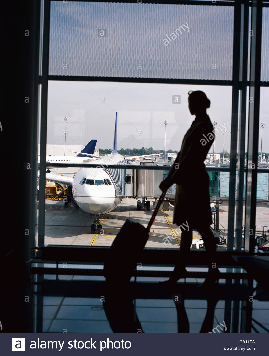 Female traveller in airport - Stock Image