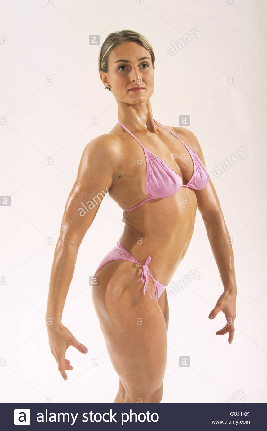 Female bodybuilder in stylized pose, portrait - Stock Image