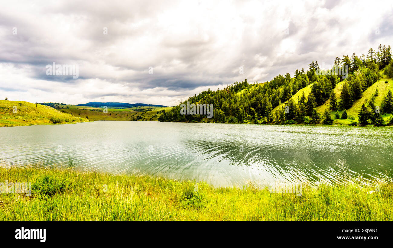 Cloudy Sky over Trapp Lake along Highway 5A between Kamloops and Merritt British Columbia Canada - Stock Image
